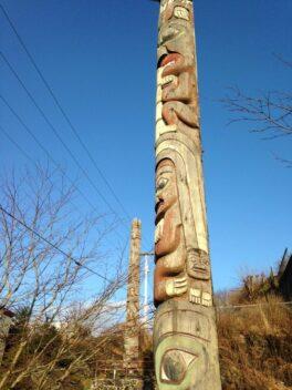 totem pole against blue sky.