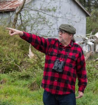 Paul Levesque surveying area of Tillamook wetland restoration.